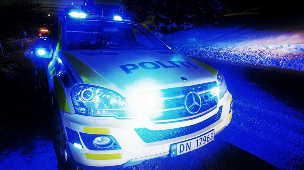 Politibil med blålys